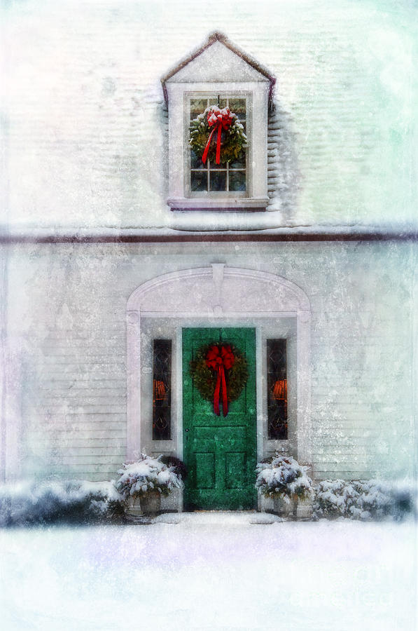 door with wreath snow
