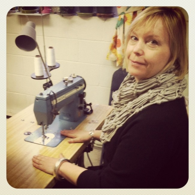 This is where the magic started. That's Annie at her original sewing machine. (Photo via Layla Grayce)