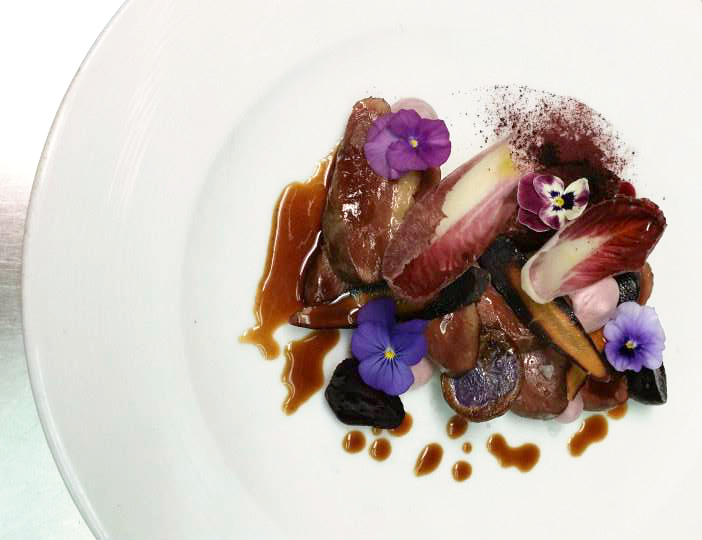 Woodfire Grill poached duck breast with black rice grits, purple ...