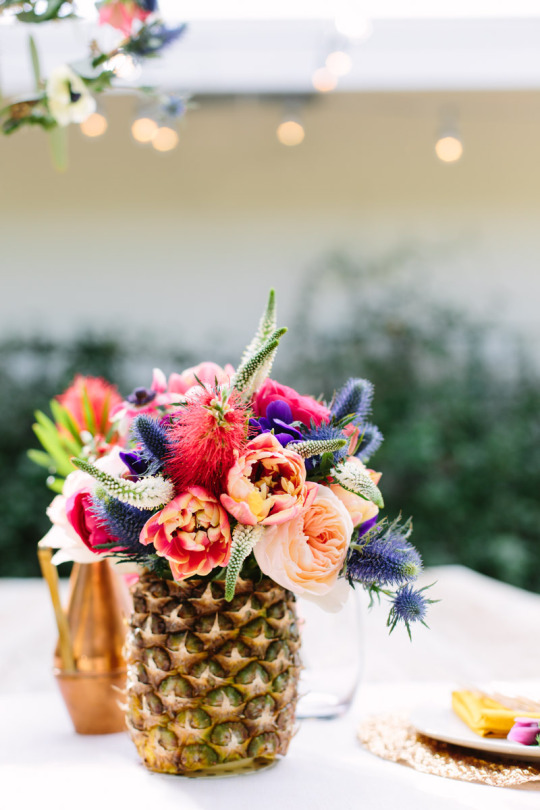 Sugar and Cloth colorful flowers in pineapple vase