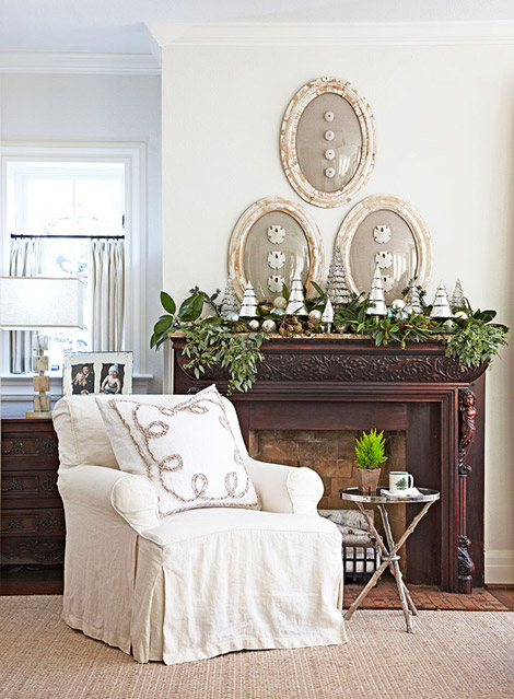 Traditional home greenery and trees holiday mantel