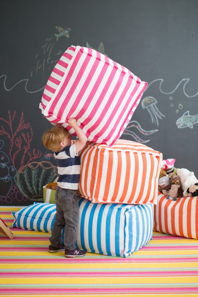 colorful playroom makeover poufs