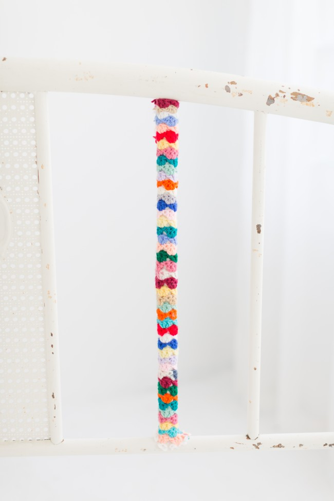how to yarn bomb a headboard 6