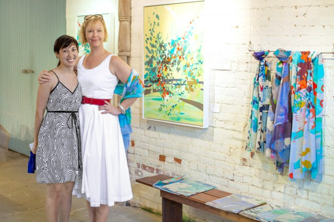 Annie (right) with artist Melissa Matsuki Lillie, whose paintings served as the inspiration for some of Annie's new scarves.