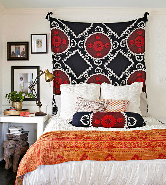 small bedroom with suzani tapestry BHG
